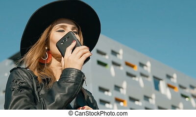 Girl Answers Phone Happily - Fashionable caucasian girl...