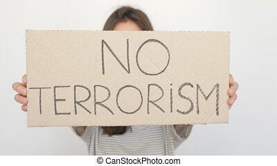 Girl Appearing against Terrorism with Tablet in White...