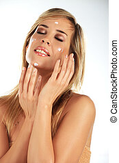 Girl applying creme on her face 2