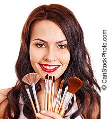Girl applying makeup.