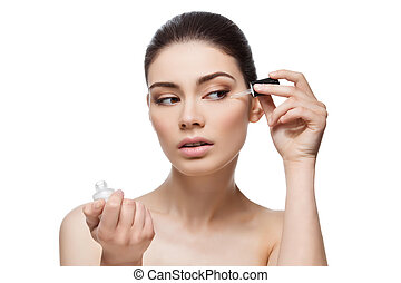 Girl applying serum - Beautiful young woman applying...