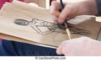 Girl artist draws sketces of female model