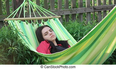 Girl asleep in hammock
