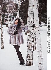 girl at a birch in winter
