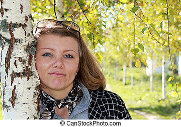 girl at a white birch