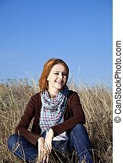 Girl at autumn field.