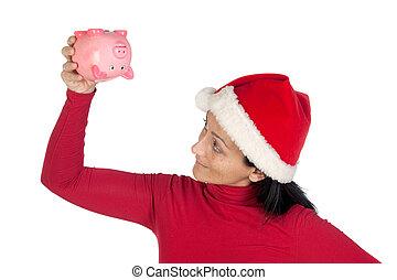 Girl at Christmas flipping a piggy bank