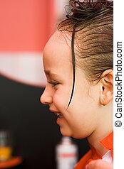 Girl at hair stylist