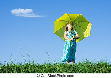 Girl at meadow with umbrella