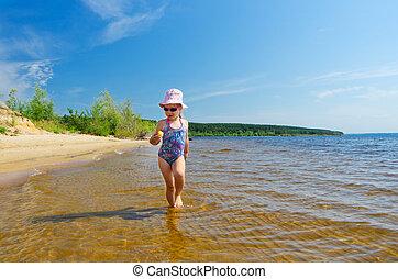 Girl at river shore