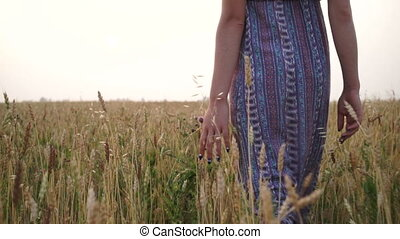 Girl at sunset in a field