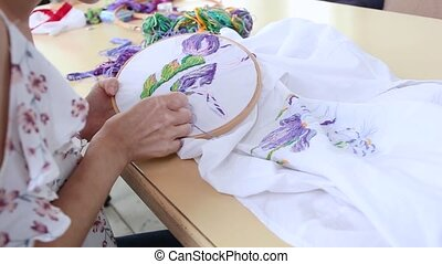 girl at table sewing with needle. needlework, embroidery, ...