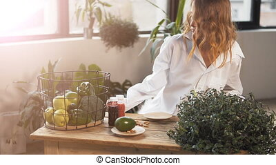 Girl At Table with Healthy Food - Fair-haired girl sitting...