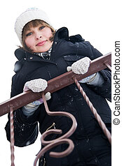 Girl at the balcony in winter day - Girl standing on the...