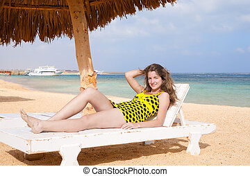 girl  at the beach on a wooden deck