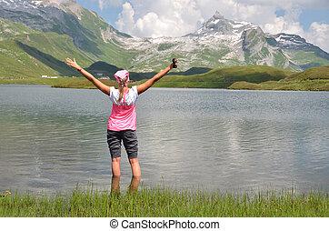 Girl at the mountain lake, Switzerland