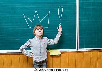 Girl at the school board with crown