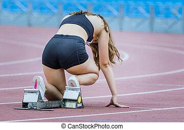 Girl athlete in starting position