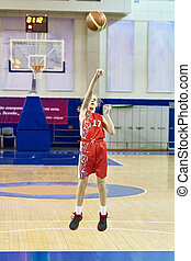 Girl athlete in uniform playing basketball