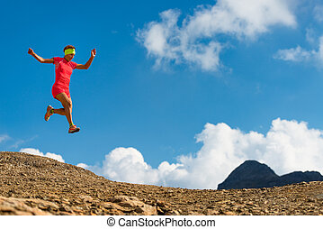 Girl athlete jumps while running