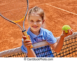 Girl athlete with racket and ball on tennis court - Kid...