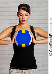 Girl athlete with the ball in his hands. Health. Sport