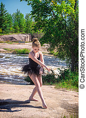 Girl Ballerina Posing Outside by River