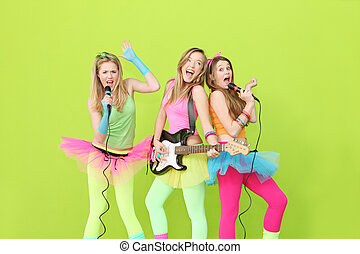 girl band, group of girls singing and playing guitar
