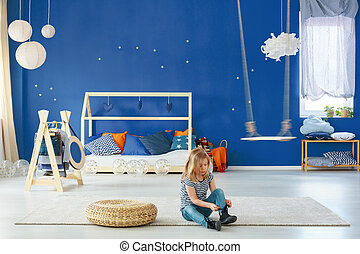 Girl bedroom with blue wall