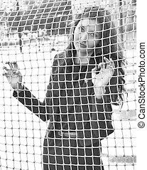 Girl behind the net