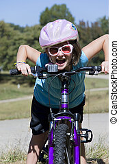 Girl Being Silly on a Bike