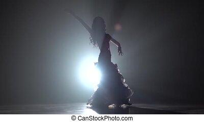 Girl belly dancer arabian in exotic white dress. Smoke...