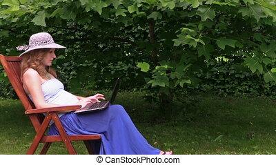 girl belly work laptop