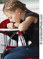 Girl bending over book