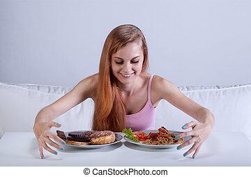 Girl binging on lots of food - Young skinny girl binging on...
