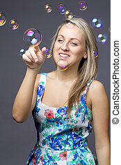 girl blonde with soap bubbles on white