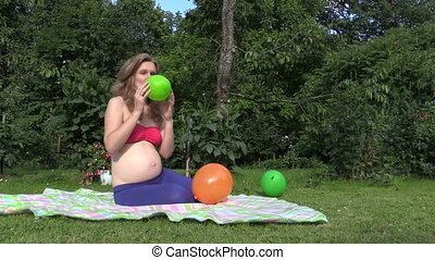 girl blow balloon - Cute pregnant woman girl inflate...