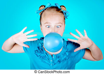 Girl blowing a blue bubble