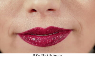 Girl blowing a kiss to her lips with red lipstick