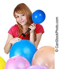 girl blowing air balloon