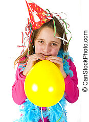 Girl blowing balloon - Little girl is blowing a balloon at...