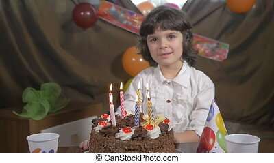 Girl blowing candles at a birthday