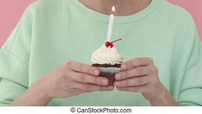 Girl blowing out candle cake - Girl holding cake her hands...