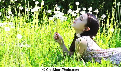 girl blows dandelions  flower