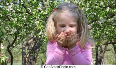 girl blows flowerses