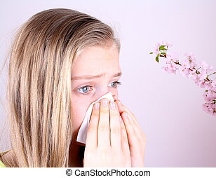 Girl blows her nose with handkerchief and cherry blossoms