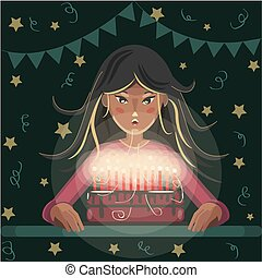 Girl blows out candles on a birthday cake