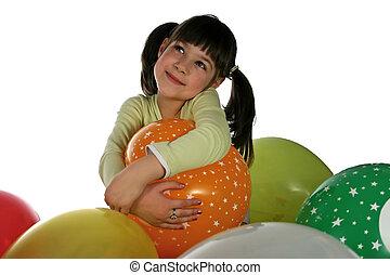 girl blows up balloon