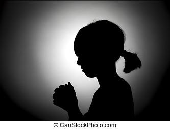 Girl bowed in prayer.