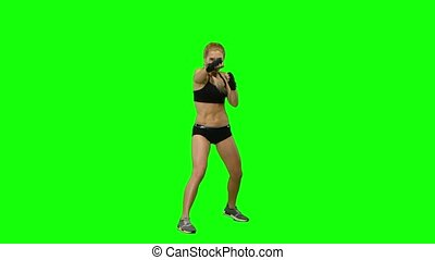 Girl boxer sends frequent blows to the enemy. Green screen